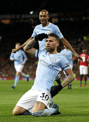 Winning look: Nicolas Otamendi celebrates scoring the winner for Manchester City in their 2-1 win over United in the last Manchester derby in December. Picture: REUTERS