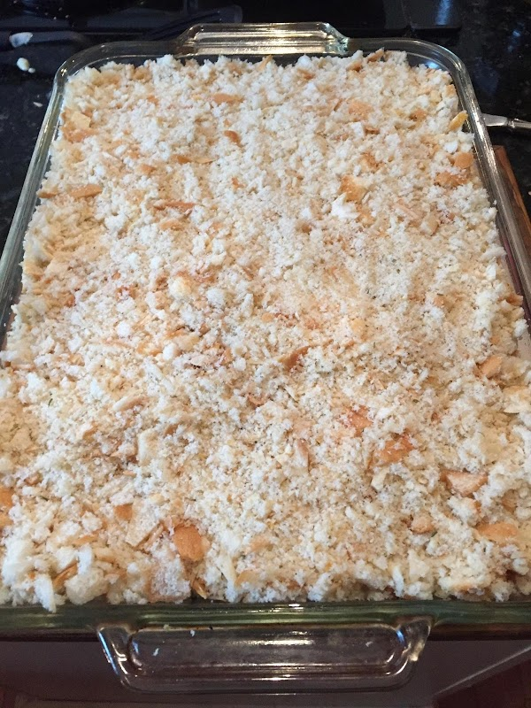 Add bread crumbs over top of the cheese.