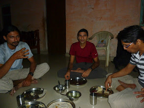 Photo: Richard Kher, Sunny Jamshedji and Ajit Bobhate eating a simple village meal before going to bed. Rice chappatis (tortillas) with two typical vegetable dishes. By the time we realized we needed to take a picture, we were done!