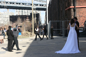 Photo: Wedding photography in part of the Brooklyn Bridge Park, with the classic, old warehouse as their background.