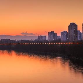 River Sava from Bridge of Liberty in Zagreb, Croatia by Dražen Škrinjarić - City,  Street & Park  Vistas ( water, sava, europe, colorful, twilight, croatia, zagreb, lights, lamps, liberty, autumn, color, sunset, buildings, bridge, river )