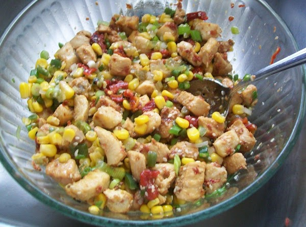 In the bowl with the corn add the cooked, cooled chicken and mix together.