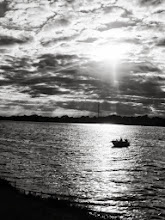 Photo: Black and white photo of a boat on a lake under the epic sky at Eastwood Park in Dayton, Ohio.