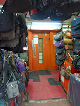 Photo: A luggage store next door