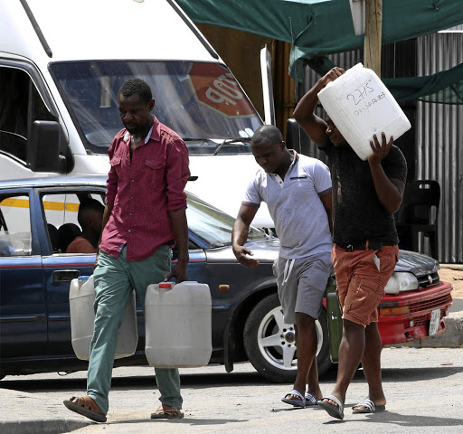 Zimbabweans going home after filling up their drums with petrol at a garage near Beit Bridge in Musina, Limpopo, because of the petrol crises in their country.