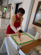 Photo: Judy Boggs cutting dessert