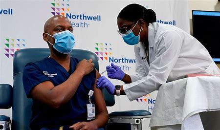Image result for front line workers getting vaccine