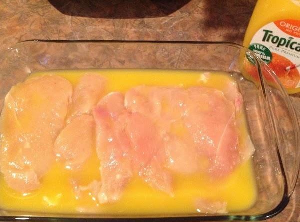Marinate chicken breasts in the orange juice, 10 - 15 minutes.