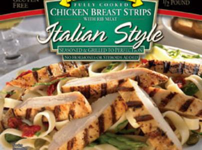 Cut the grilled chicken stripes into small pieces and warm in a skillet over...