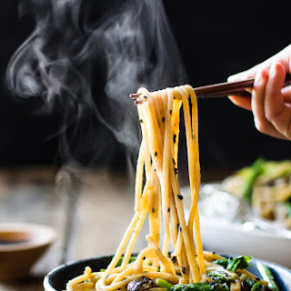 Hot Sesame Rice Noodles with Asparagus, Shiitakes and Pea Shoots.