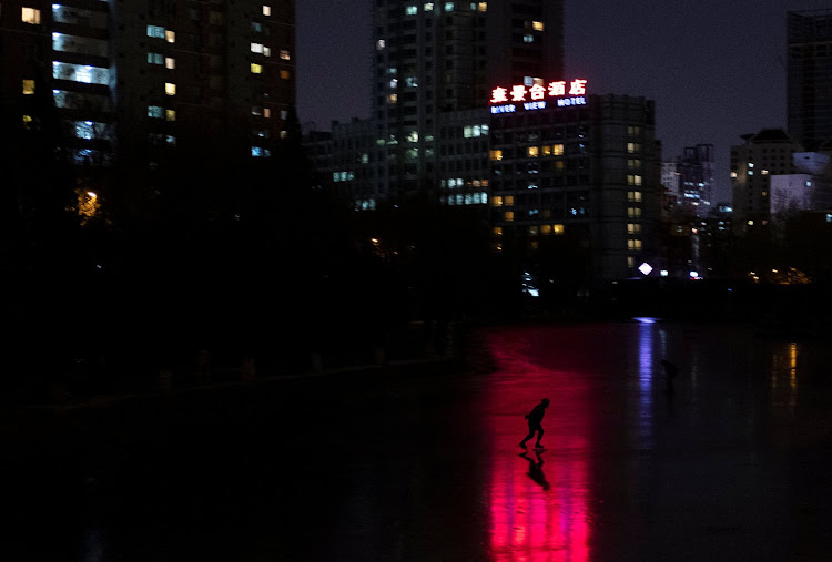 A man skates on a frozen river near the CBD in Beijing.