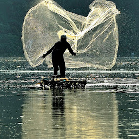 early morning fishing by Deny Satria - People Street & Candids ( indonesia, lake, traditional, fishing, morning, fisherman, misty )