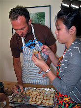 Photo: Jim and Mai spreading shrimp mixture on baguette slices