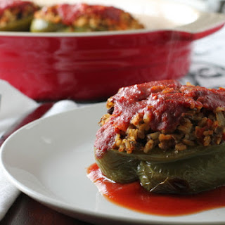 Lentil and Rice Stuffed Peppers with Sweet and Spicy Tomato Sauce.