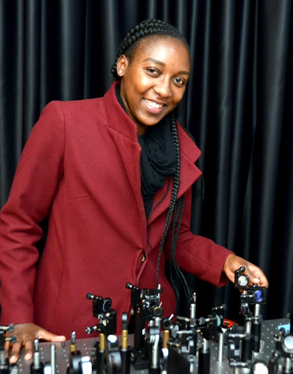 Nokwazi Mphuthi poses for a picture at a laboratory.