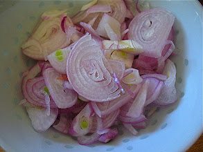 Photo: sliced shallots for roasted eggplant salad