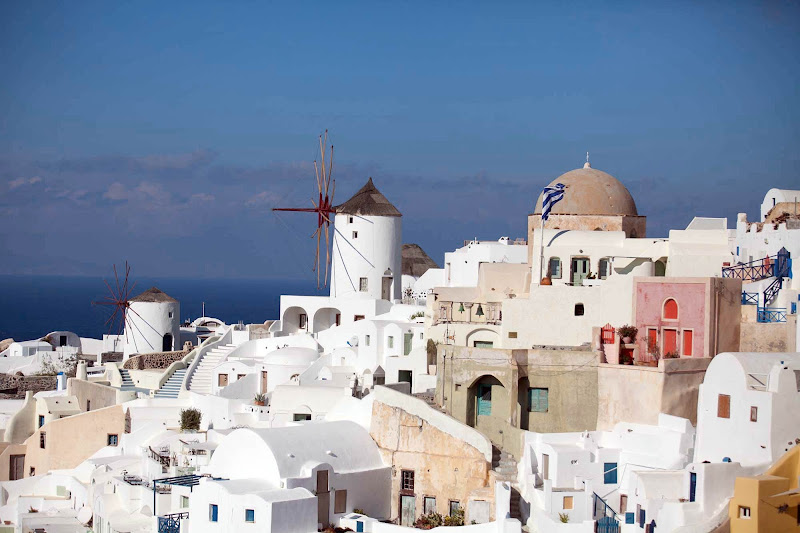 Two windmills stand out in a cluster of sugar-cube buildings in Oia at the north end of Santorini.