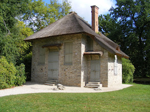 Photo: The rustic cottage exterior.conceals an elegant interior decor of mother of pearl and marble.