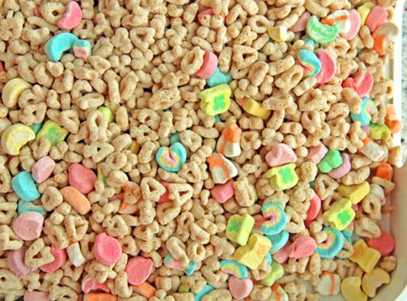 Pour box of cereal out onto a large tray.