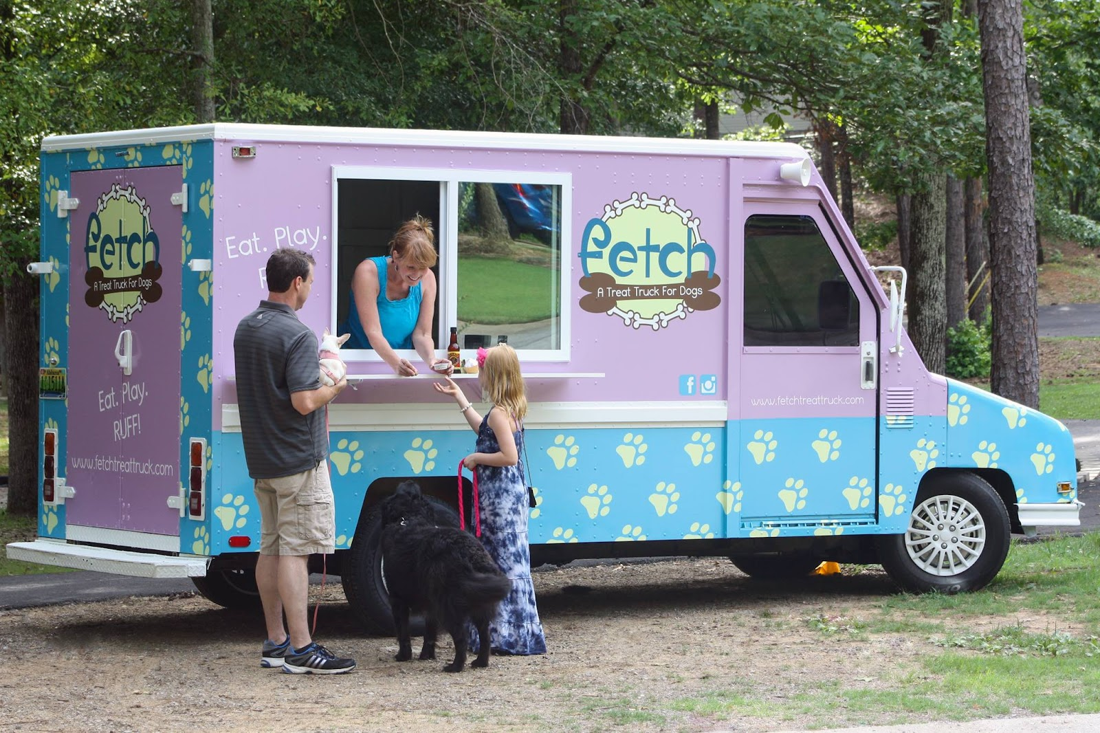 dad and little girl at Fetch treat truck for dogs