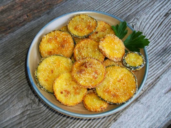 Taste-test one of the fried squash slices to determine if it needs a sprinkle...
