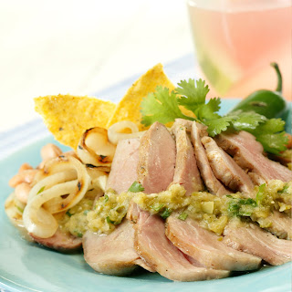 Grilled Tenderloin with Cumin, Green Tomatillos and Onion Salsa.