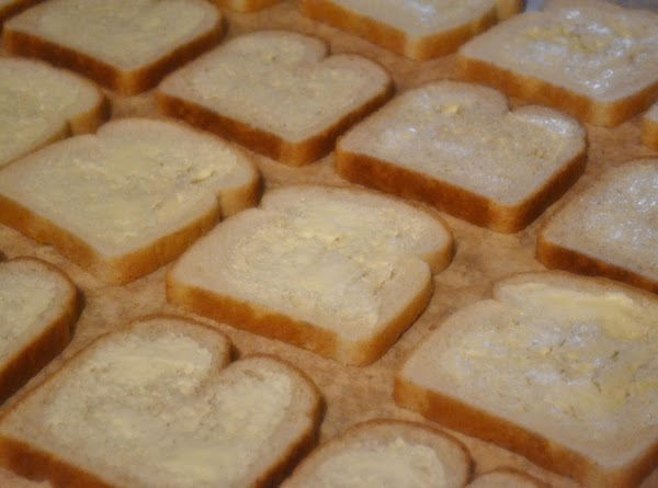 Spread a thin layer of margarine (or butter) on one side of each slice...