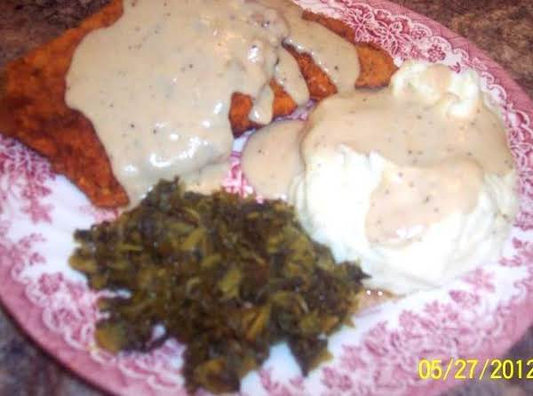 Golden Fried Cubed Pork And Gravy, Cream Cheese Mashed Potatoes And Collard Greens..mmmmmmmm!