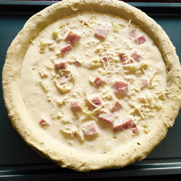 Pour egg mixture over cheese mixture in shell.  Place pie on sheet pan....