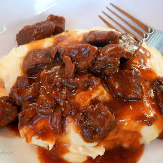 BBQ Steak Tips Over Mashed Potatoes.