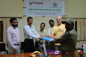 Photo: Philip Davis meeting with Field Director Bandhavgarh for distribution of mosquito nets and torches in 2008