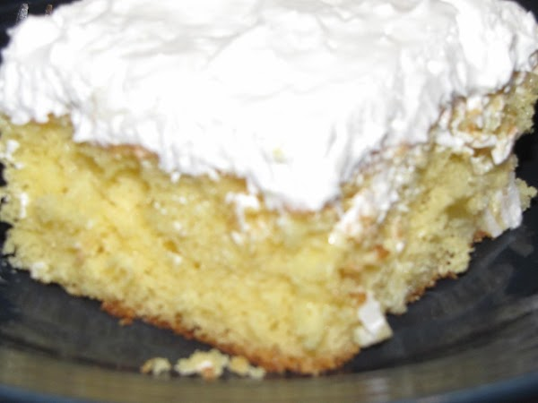 Fold the coconut into the whipped topping. Spread the mixture onto the cake. Refrigerate...