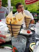 Photo: debriefing the race over pom frites at the Grand Hotel's Jockey Club