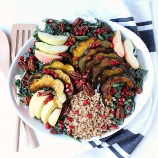 Fall Harvest Kale & Farro Salad w/ Roasted Acorn Squash, Apples, Candied Pecans, Pomegranate Seeds, & Sweet Apple Cider Vinaigrette.