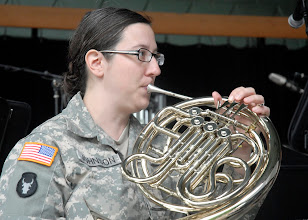 Photo: Sgt. Jill Johnson played the french horn during the 34th Red Bull Infantry Division Band's performance at the Minnesota State Fair's Military Appreciation Day Aug. 30, 2011 in St. Paul, Minn.