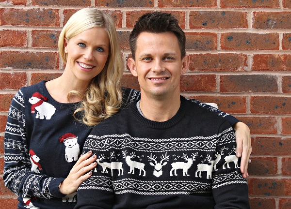 Couple in Christmas jumpers