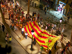 Photo: September 11 is Catalonia Day, and the main parade went right down our street. The flags with the stars at the top (most, if not all, that you see in this photo) represent the movement for Catalonian Independence - as each year passes, the movement gets stronger and stronger.
