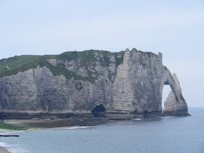 Photo: It's these limestone cliffs and arches which are the town's main attraction. Here, a view along the Aval Falaise, the more popular one for walking, and the one we would ascend. We see the Aval Arch, with the Needle (Aiguille) behind.