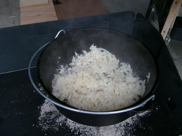 Using the sausage drippings in the pan, brown potatoes and spread them evenly in...