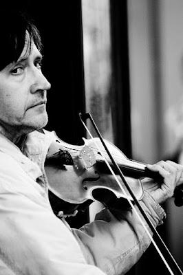 Il violinista di strada di Fotoramu