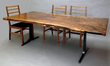 Photo: http://dorsetcustomfurniture.blogspot.com/2012/02/claro-walnut-slab-dining-table.html