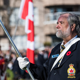 Tribute To Our Heroes by Garry Dosa - People Street & Candids ( flag, poppy, remembrance day, remembering, uniforms, people, red, uniform, standing, celebration, outdoors, white, ceremony, person, solemn, man, male )