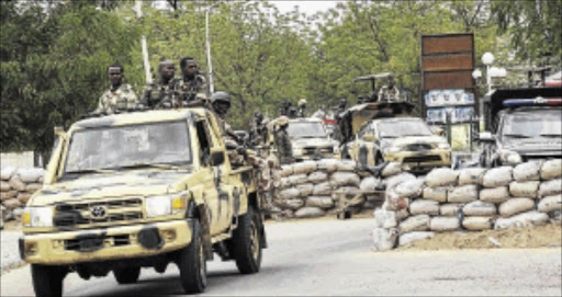 Members of the Nigerian military patrol in the town of Maiduguri.