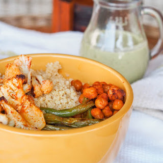 Vegan Quinoa Roasted Veggie Buddha Bowls with Creamy Pesto Tahini Sauce {GF}.