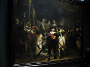 Photo: The Night Watch. Really is noticeable when you see it in person how the trimming they did on it throws off the balance and dimensions. Overall, REALLY BIG painting. The crouching girl to the right of the man in red is Rembrandt's wife, Saskia.