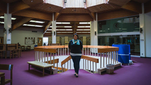 Robin on the upper-level of the Diné College library.