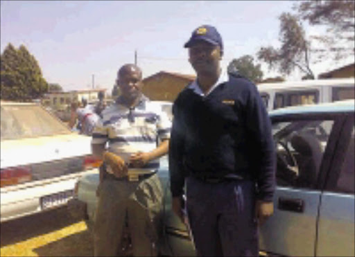 EXHIBIT: Officers Jan Phosele and Hasting Chaane in front of the stone car kept at the Mmametlhake police station yard. Pic. Alfred Moselakgomo. 28/08/2008. © Sowetan