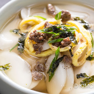 Tteok guk (떡국) – Korean rice cake soup.