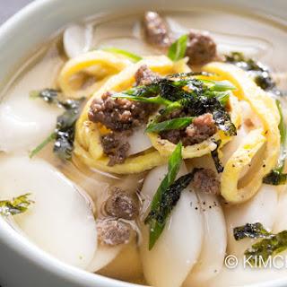 Tteok guk (떡국) – Korean rice cake soup.