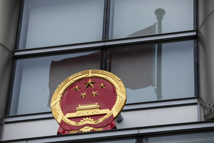 The Chinese emblem on the office for safeguarding national security in Hong Kong, temporarily set up at the Metropark Hotel, on July 8 2020. Picture: BLOOMBERG/CHAN LONG HEI